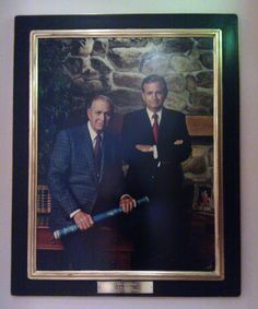 The portrait of the Marriott's that looks over the reception desk of their hotels